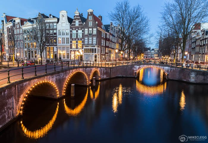 Amsterdam canals, bridges and buildings at night