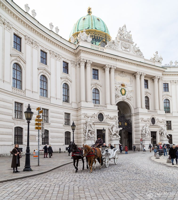 Hofburg Palace in Vienna with a Fiaker
