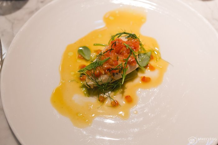 John Dory with tomatoes, herbs and butter