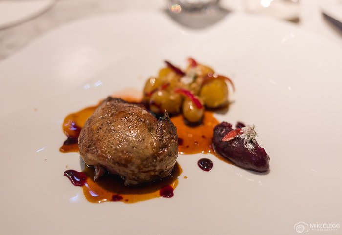 Pigeon from Les Costieres with cherry, onions, potatoes and coriander