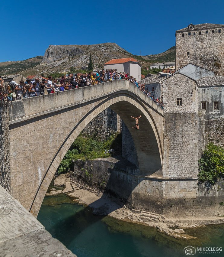 Jumpers performing along Stari Most Bridge