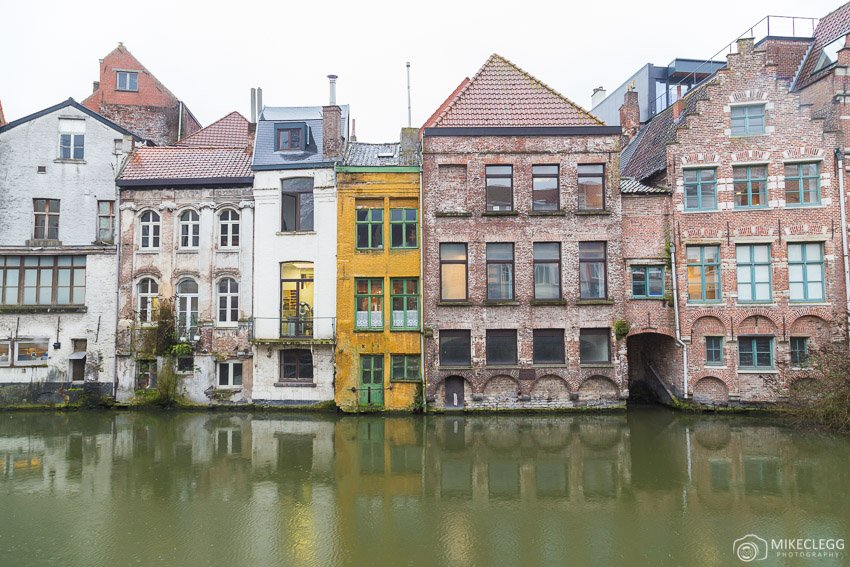 Old architecture along the river Leie