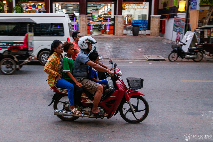 Groups of people on bikes in Cambodia