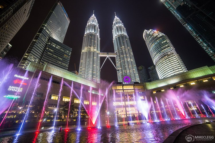 Light show outside Suria KLCC and Petronas Twin Towers at night