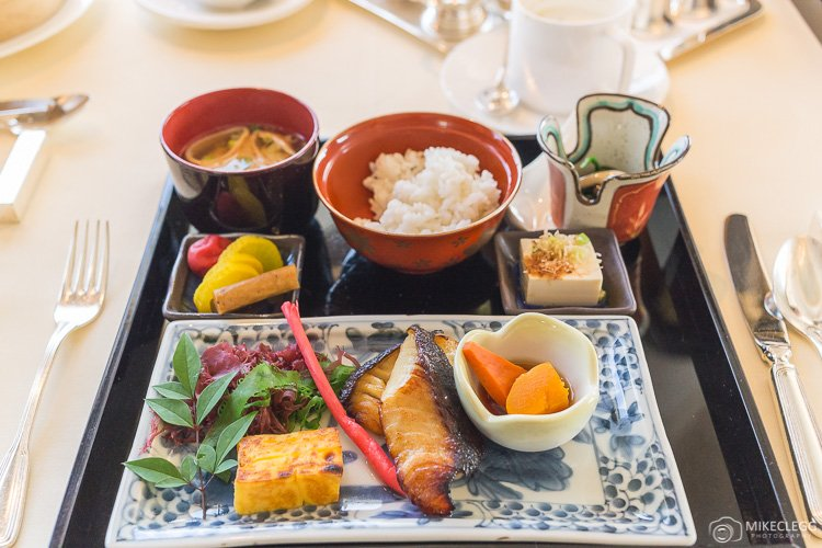 Traditional Japanese Breakfast with Grilled fish, vegetables, miso soup and rice