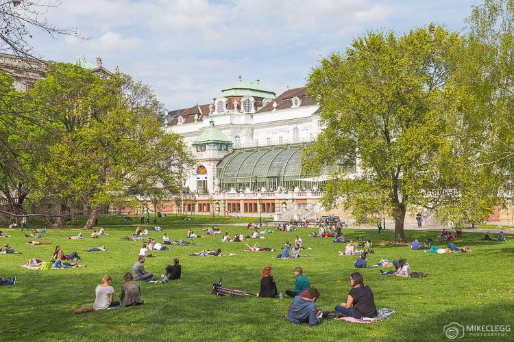 People relaxing in the Burggartenin Vienna in the summer