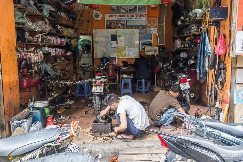 Men working in motorbike shops in Hanoi