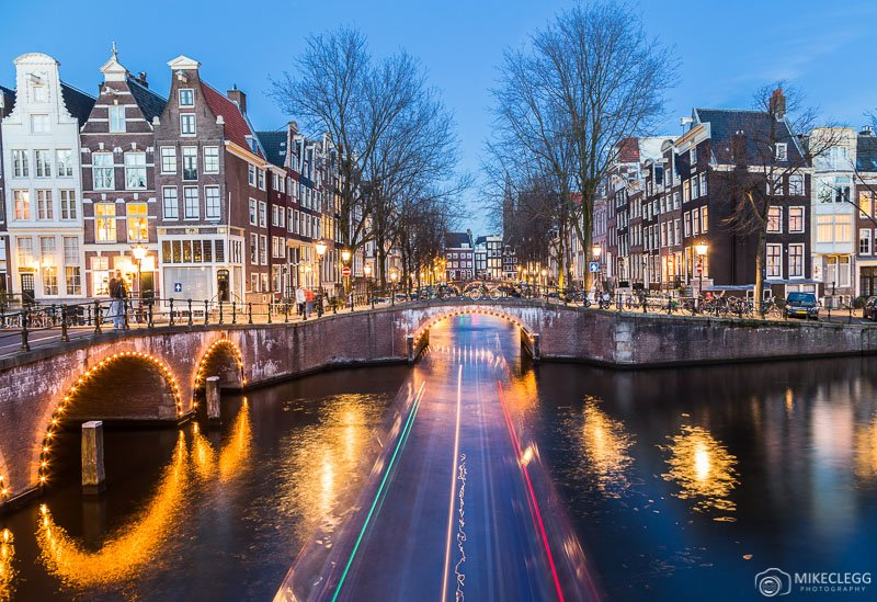 Canals and architecture in Amsterdam at night