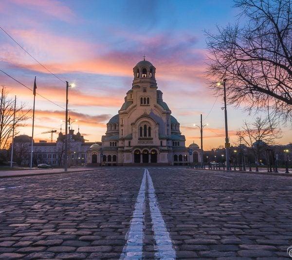 Road leading towards Cathedral Saint Alexandar Nevski during a colourful sunrise