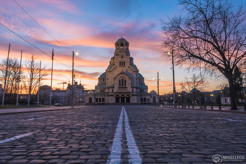 Road leading towards Cathedral Saint Alexandar Nevski during a colourful sunrise