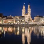 View across Limmat towards the Grossmünster Church at night