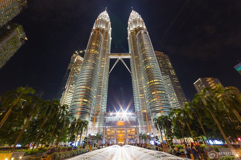 Front of Petronas Towers at night in Kuala Lumpur