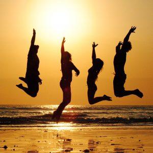 Group holiday - Sunset on a beach - CC0 (Pixabay)