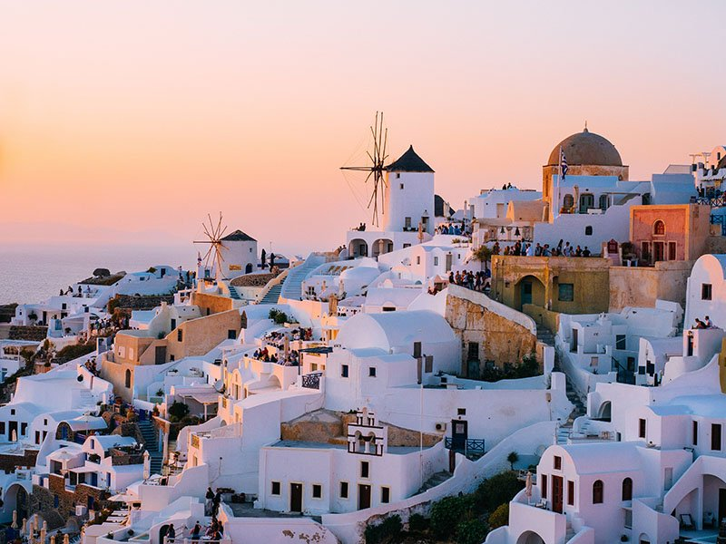 Santorini at sunset - tom-grimbert-unsplash