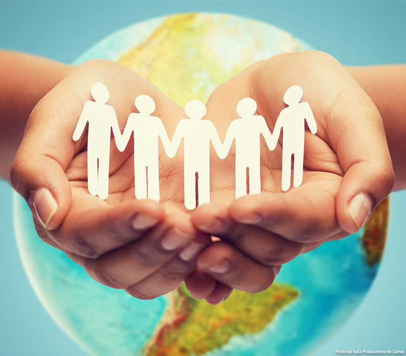 People holding hands and helping each other around the world - concept