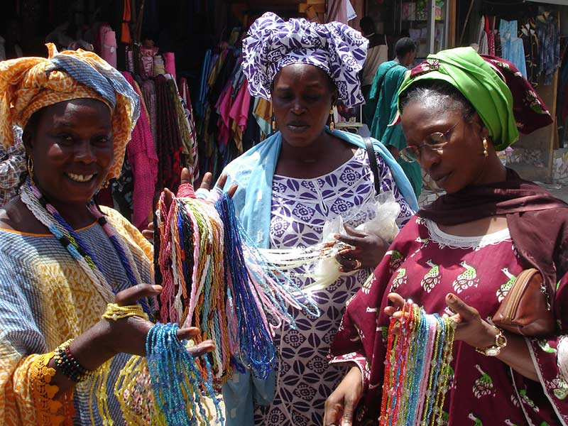 Colourful bead merchants at Dakar market, photo by BobbiLe Ndiaye