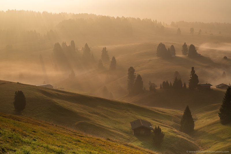 Seiser Alm at sunrise with beams of light