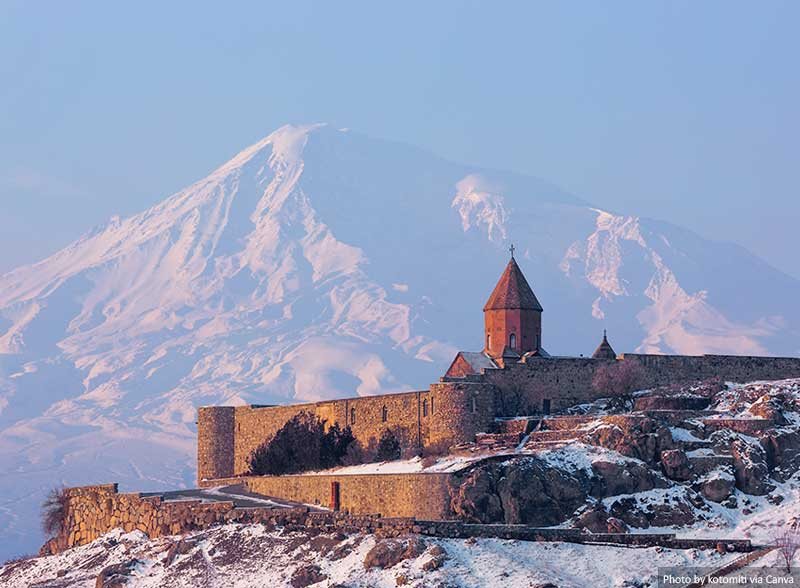 Ancient Armenian church Khor Virap with moutains in the background