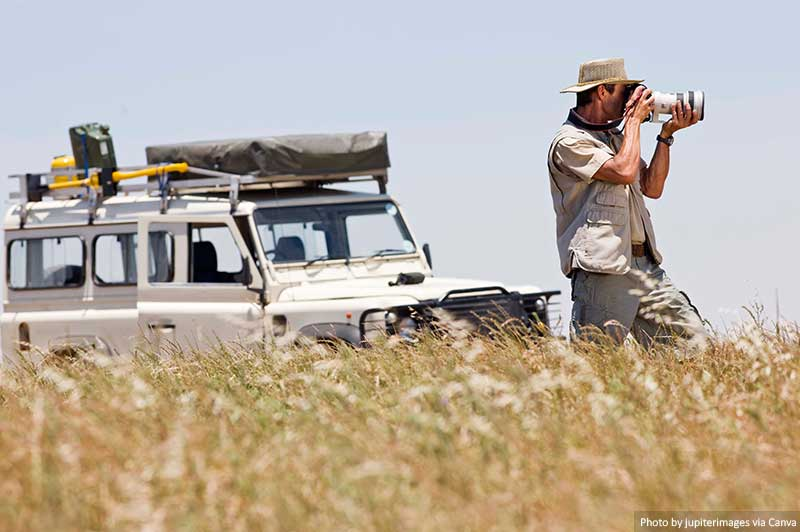 Man on a safari taking pictures
