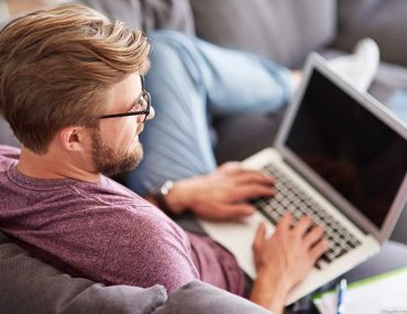Man at home with laptop