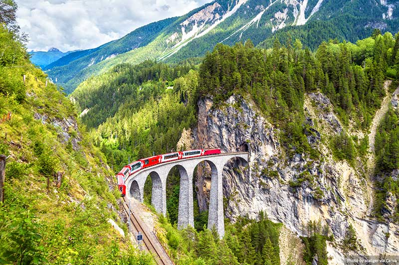 Landwasser Viaduct. Bernina Express on railroad bridge in Switzerland
