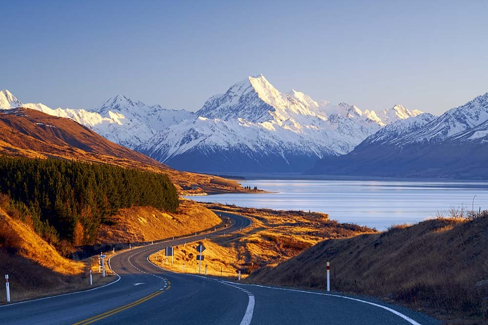 Mount Cook and road alongside Lake Pukaki in New Zealand